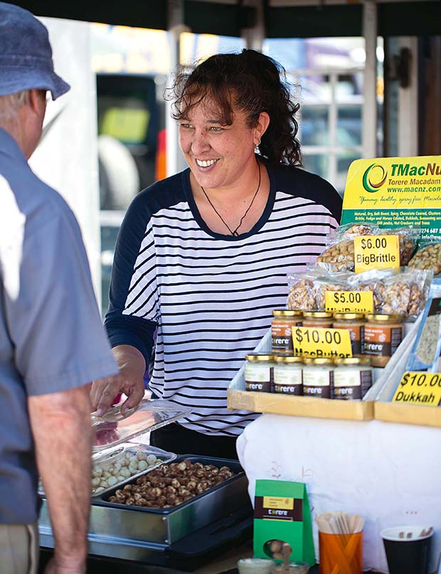 Vanessa's daughter, Angelina, helps out at the market.