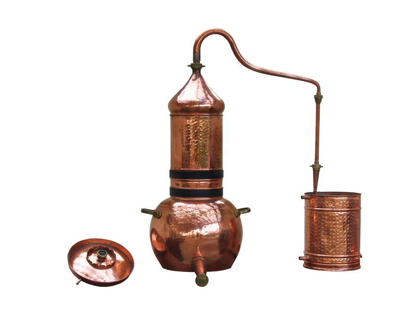 A copper alembic still used for distillation.