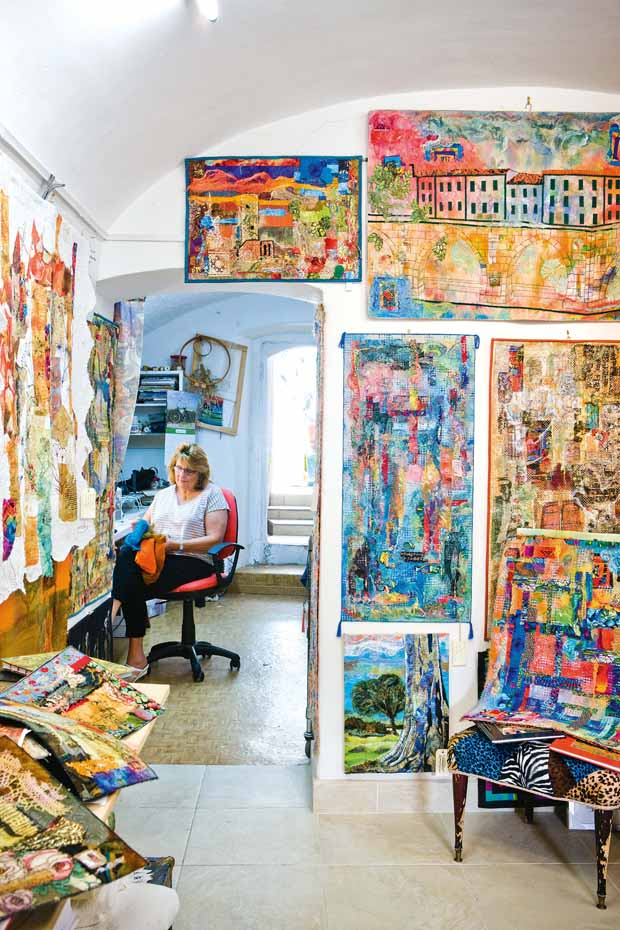 A converted wine cellar make s a perfect studio for Averil, who can spend up to 12 hours a day working on her art surrounded by trunks of fabric treasures unearthed from attics, street markets and second-hand shops in Italy and New Zealand.