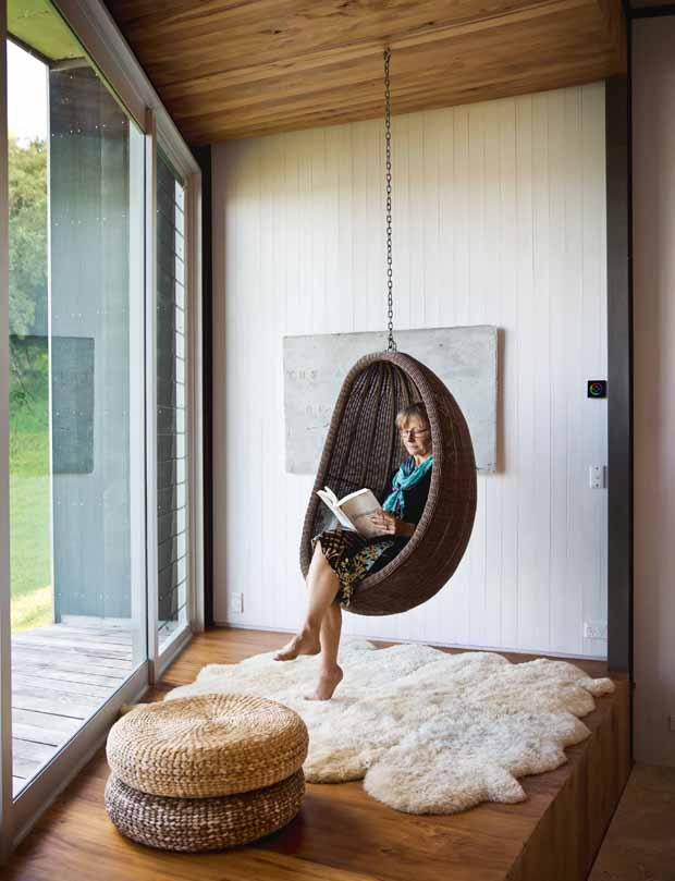 Isobel has a favourite corner of the house and often hangs in her swing chair keeping a careful eye on the 13 royal spoonbills that frequent Takahoa Bay.
