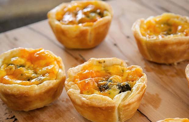 Red leicester cheese and pesto tarts.