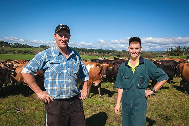 Dairy farmer Carl Williams with assistant Joshua Watson.