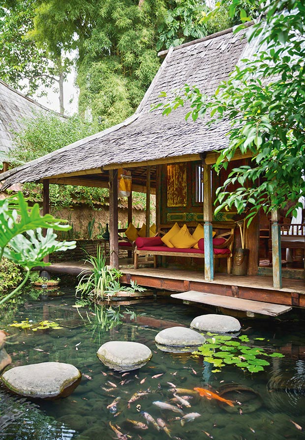 Stepping stones into the resort's Kolam House.