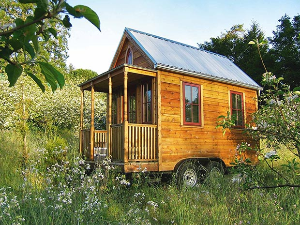 This tiny house includes a porch, bathroom, kitchen and an upstairs loft for sleeping in a space measuring 2.4m wide by 4.6m.
