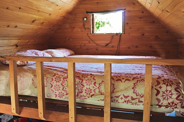 The 'master bedroom' is tucked up on a mezzanine in the main bedroom and accessed by a ladder, with just enough room for a queen bed. From the bed we can watch all three of our children sleeping which is lovely when they're asleep (not so lovely when they're not).