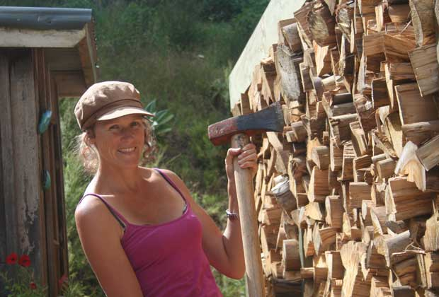Blogger Polly Greeks chopping wood